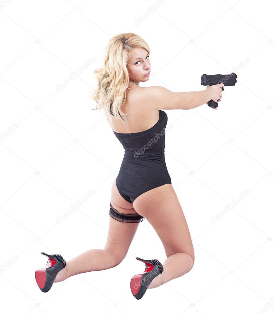Young beautiful blond girl holding gun — Stock Photo #10577046