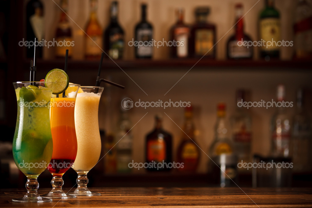 Three tropical mixed drinks, shot in bar with space for copy — Stock Photo #10578689