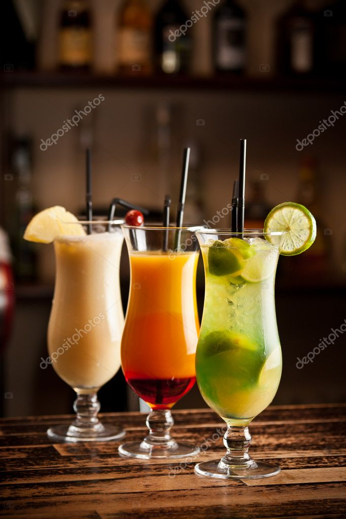 Three fresh cocktails on a bar table  Stock Photo #10578785
