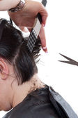 Woman cutting hair — Stock Photo