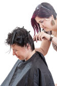 The hairdresser make the haircut — Stock Photo