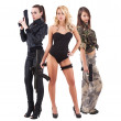 Three attractive young women with guns — Stock Photo