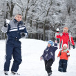 图库照片: Family playing with snow