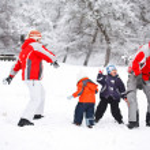 Family having fun in snow — Stock Photo