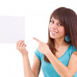 Young woman pointing at blank card in her hand — Stock Photo
