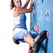 Athletic girl climbing — Stock Photo