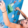 Woman on climbing wall — Stock Photo