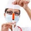 Young nurse in mask — Stock Photo #9203702