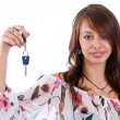 Woman holding a key — Stock Photo #9203854