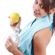Woman holding bottle of water and apple — Stock Photo