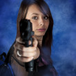 Freestyle woman posing with guns — Stock Photo #9203999