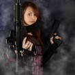 Freestyle woman posing with guns — Stock Photo #9204001