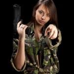 Girl holding pistol — Stock Photo