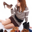 Woman surrounded by shoes — Stock Photo