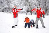 Family in snow — Stock Photo