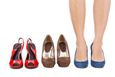 Woman choosing shoes concept — Stock Photo
