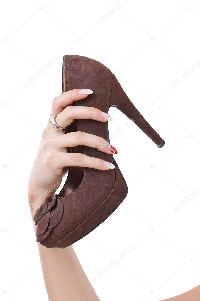 Female hand holding brown shoe, isolated on white — Stock Photo #9203422