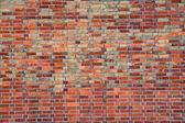 Old worn red brickwall — Stock Photo