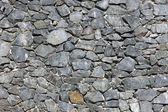 Grey natural stone wall — Stock Photo
