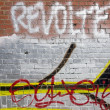 Graffiti on red wall in Berlin — Stock Photo #8866686