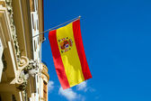 Spanish flag flying at an old building — Stock Photo