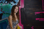 Slim girl and graffiti — Stock Photo