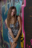 Girl and graffiti wall — Stock Photo
