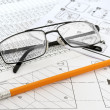 Glasses,  pencil and paper workers — Stock Photo