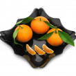 Tangerines in a plate — Stock Photo #10558924