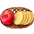 Apples and biscuit in basket — Stock Photo