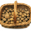 Wicker basket with nuts - Stock Photo