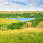 Small lake and scenic hills — Stock Photo