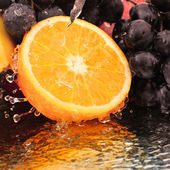Pure fruit in a spray of water — Stock Photo