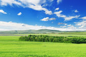 Mountainous terrain and the blue sky — Стоковое фото