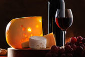 Still-life with cheese, grape and wine — Stock Photo