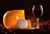 Still-life with cheese, grape and wine. — Stock Photo