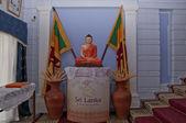 Buddha and the flags of Sri Lanka — Stock Photo