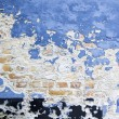 Blue paint peeling brick wall — Stock Photo