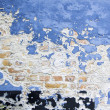Blue paint peeling brick wall — Stock Photo #9294184