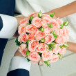 Hand in hands with rose bouquet. Wedding couple — Stock Photo