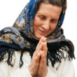 Old age praying woman on white background - Stock Photo
