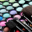 Multi colored make-up and brushes - Zdjęcie stockowe