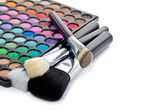 Multi colored make-up and brushes — Stock Photo