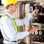 Technician checking machine control box temperature — Stock Photo #10212892