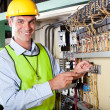 Technician repairing machine - Stock Photo
