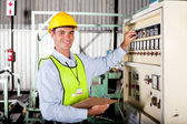 Technician setting up industrial machine — Stock Photo