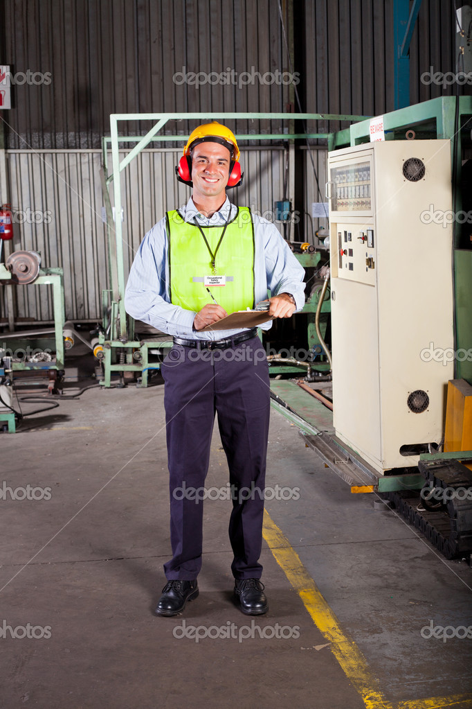 Male occupational safety inspector inside factory — Stock Photo #10212230