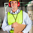 Industrial worker with personal protective equipment - Stock Photo