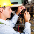 Electrician testing industrial machine — Stock Photo #10229600