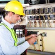 Electrician changing machine switch — Stock Photo